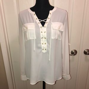 Long sleeve or cuffed tie front peasant blouse.
